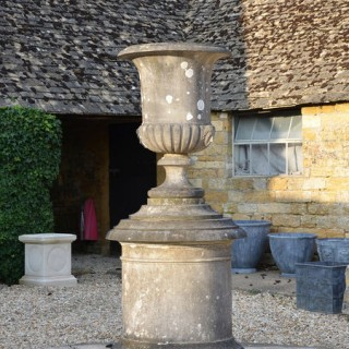 A magnificent marble Campana shaped urn on circular pedestal