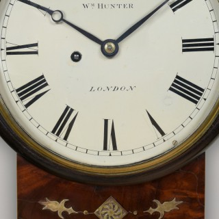 A fine early 19th century dropbox wall timepiece  by  WM. HUNTER.