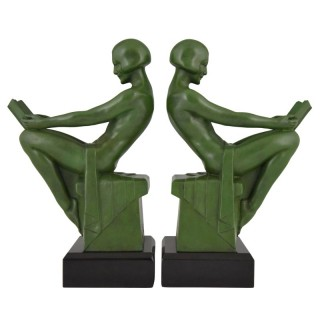 Art Deco bookends reading nudes