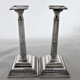 Good pair cast George III silver taper sticks London 1802 by GH