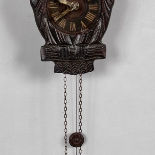 A very decorative and original moving eyes Black Forest Owl wall clock.