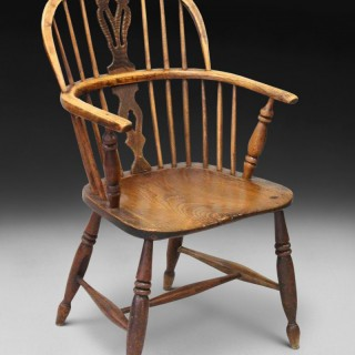 A late 18th century Elm, Oak and Ash Low Back Windsor Armchair