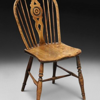 A late 18th century Elm and Oak Low Draught Back Windsor side chair