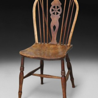 A late 18th century Elm and Oak Low Wheel Back Windsor side chair