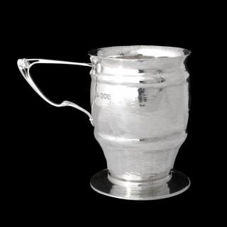 An art nouveau silver mug