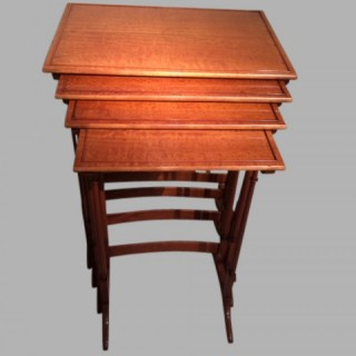 Nest of four satinwood tables.
