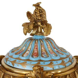 Two Sevres style porcelain and gilt bronze urns