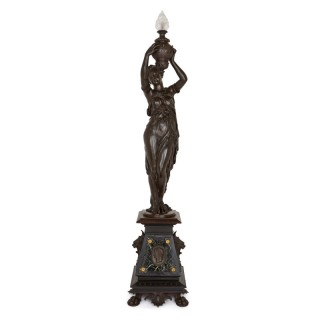 Patinated bronze torchère with classical female figure