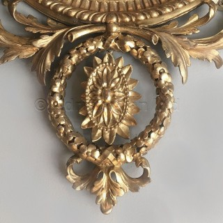 A  Fine Pair of George III Style Giltwood and Composition Oval Mirrors
