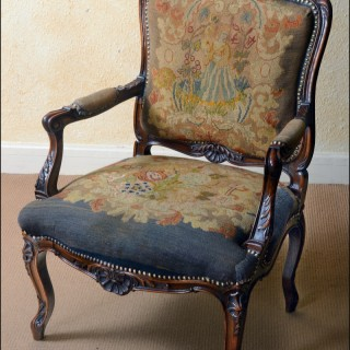 A later 19th century French walnut armchair