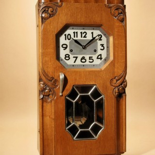 A Decorative French Art Deco Carillon Oak Wall Clock.