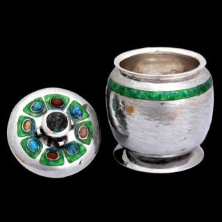 A rare Liberty & Co Cymric silver lidded jar by Oliver Baker