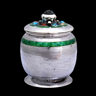 A rare Liberty & Co Cymric silver lidded jar by Oliver Baker