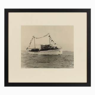 Early silver gelatin photographic print of the sailing yacht Curlew dressed overall, by Kirk and sons.  Signed in white ink.