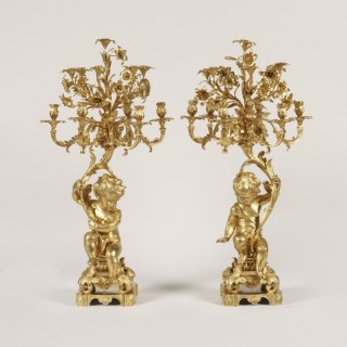 A Large Pair of Ormolu Candelabra in the Louis XV Manner By Raingo Frères