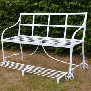 A Regency wrought iron garden games seat