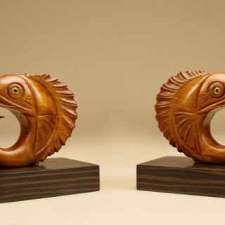 A pair of Very Stylish Art Deco Madagascar ebony (coromandel) and Hardwood Bookends Jumping Fish with glass Eyes.