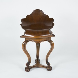 Piano Stool with shell shaped seat