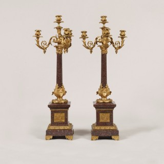 A Pair of Louis XVI Style Porphyry and Ormolu Candelabra