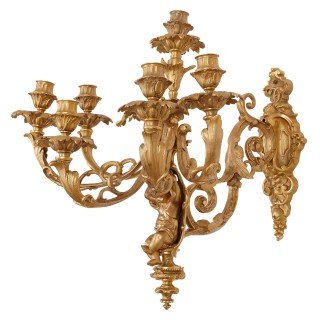 Two French Rococo style gilt bronze six-light sconces