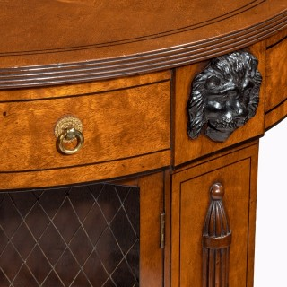 Regency plum-pudding mahogany library centre table and bookcase,