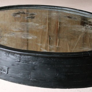 A Large Primitive Mid-Century Black Painted Oval Wall Mirror