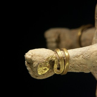A Bone Votive Statuette of a Woman