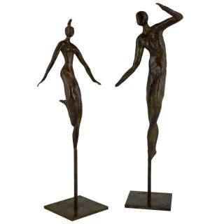 Pair of modern bronze sculptures dancing couple