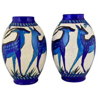 A Pair of Art Deco ceramic vases with blue deer.