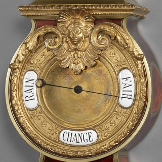 A Tortoiseshell-Inlaid 'Boulle' Cartel Clock and Barometer Set