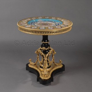 A Louis XVI Style Gueridon with Porcelain Plaques