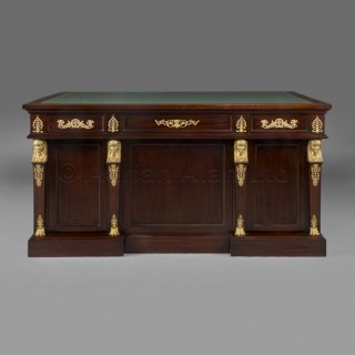 A Napoleon III Gilt-Bronze Mounted Empire Style Mahogany Pedestal Desk