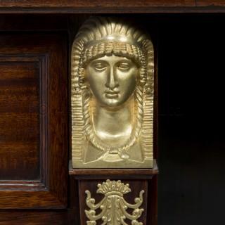 A Napoleon III Gilt-Bronze Mounted Empire Style Mahogany Pedestal Desk
