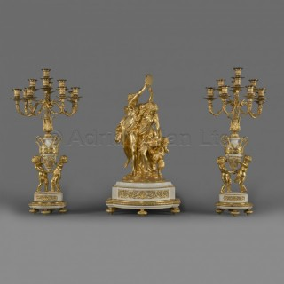 A Napoleon III Gilt-Bronze and White Marble Three-Piece Garniture