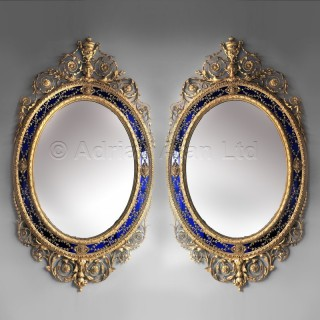 A Magnificent Pair Of George III Style Oval Giltwood Mirrors In The Manner of Robert Adam