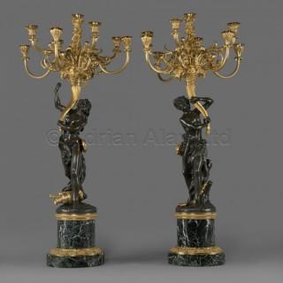 'Les Grands Faunes', A Pair of Bronze Figural Candelabra