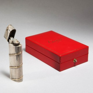 SOLID SILVER LIGHTER WITH GOLD BANDING – CARTIER