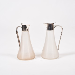 PAIR OF RIBBED GLASS CLARET JUGS BY WMF