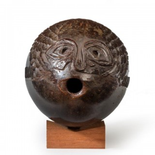 "A naïve coconut shell ""bugbear"" powder flask carved as a fish"