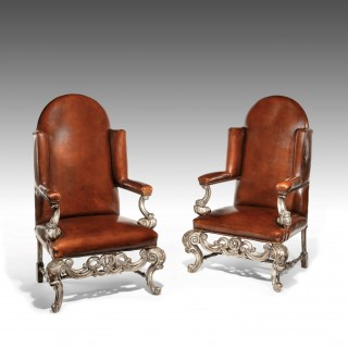 Antique Pair of Silver Gilt Leather Upholstered Wing Chairs.