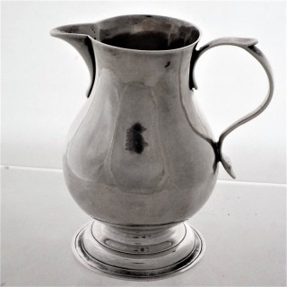 Good crested George II silver sparrow beak jug London 1733 John Gamon