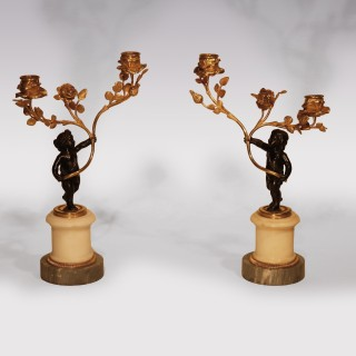 A Pair Of Early 19th Century Bronze And Ormolu 2-Light Cherub Candelabra