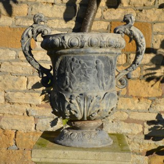 A large pair of ornate lead urns