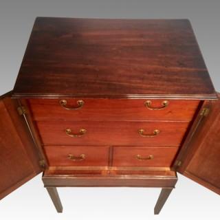 A small Geo III mahogany cabinet.