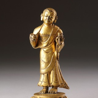 Tibetan Cast and Gilded Copper Portrait Sculpture of a Buddhist