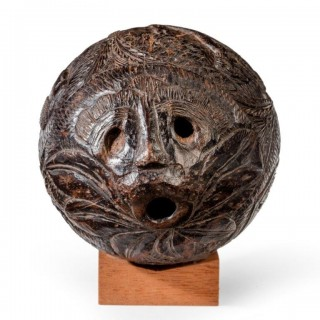 "A naïve coconut shell ""bugbear"" powder flask"