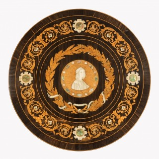 A decorative intarsia roundel in the Renaissance style, attributed to Giovanni Battista Gatti