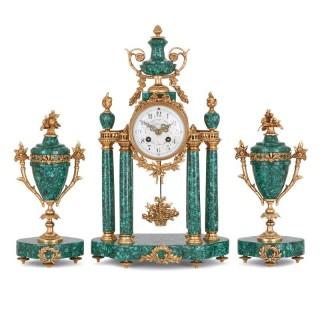 Neoclassical style gilt bronze mounted malachite clock set