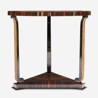 AXEL EINAR HJORTH – EBONY MACASSAR AND PARCEL GILT TABLE