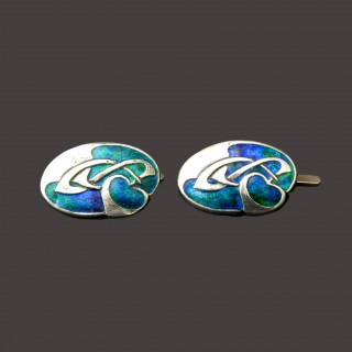 A pair of Archibald Knox silver enamel cufflinks for Liberty & Co